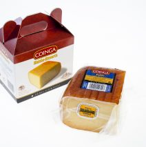 A quarter of matured cheese in a box