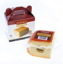A quarter of semi-matured cheese in a box